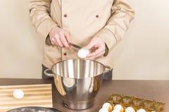 Cook chicken eggs splits. Chef knife splits chicken eggs Stock Photography