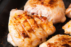 Cook chicken  with spice on frying pan Stock Photo