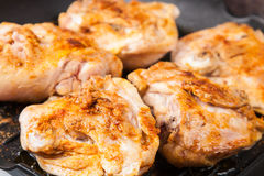 Cook chicken  with spice on frying pan Stock Photography
