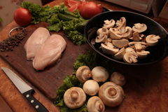 Cook chicken and vegetables stock image
