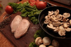 Cook chicken and vegetables Royalty Free Stock Image