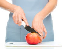Cook is chopping apple Royalty Free Stock Image