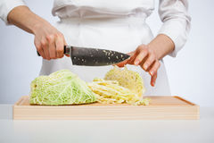 Cook chopping savoy cabbage Stock Photo
