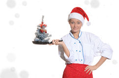 Cook with Christmas tree in pan covered and snow Stock Photo