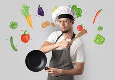Cook with colourful drawn vegetables. Bearded cook with colourful drawn vegetables on a white wallpaper royalty free stock images