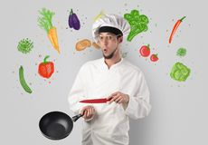 Cook with colourful drawn vegetables. Bearded cook with colourful drawn vegetables on a white wallpaper royalty free stock photos
