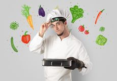 Cook with colourful drawn vegetables. Bearded cook with colourful drawn vegetables on a white wallpapern stock images