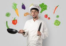 Cook with colourful drawn vegetables. Bearded cook with colourful drawn vegetables on a white wallpapern royalty free stock image