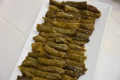 Stuffed grape leaves in Turkish style. Cook cooked cooking cookery diet dish food epicure grape healthy leaf leaf meal plate rice stuffed traditional turkish Royalty Free Stock Photography