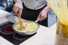 Cook cooking bulgur Stock Photos