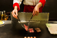 The cook is cooking food Royalty Free Stock Photo