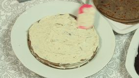 Cooking oreo crape cake. Cook cooking oreo crape cake in the home kitchen closeup stock video