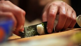 Cooking a sushi at home. Cook cooking sushi at home stock footage