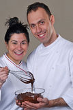 Cook couple tasting chocolate Stock Photography