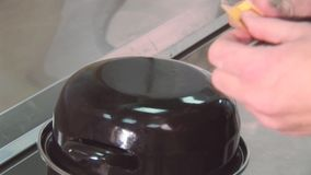 Cook cover pan with mussels, greenery, basil on table. Glue yellow sticker. Restaurant kitchen stock video footage