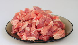 Cook, cut meat. Light background, food, cook meat,  pork process Royalty Free Stock Photos