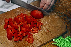 Cook cut the tomatoes into pieces Royalty Free Stock Photography