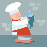 Cook cut up fresh fish. chef in kitchen. Cook cut up fresh fish. The chef in the kitchen. Food meat Stock Images
