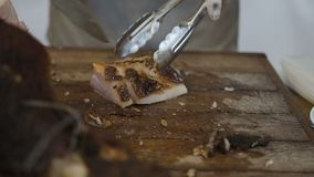 The cook cuts the delicious baked juicy meat. Slow motion stock footage