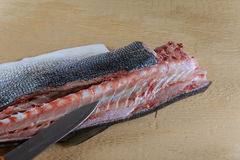 Cook cuts fish full collection Royalty Free Stock Photo