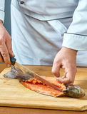 Cook cuts fish full collection of food recipes Stock Images