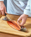 Cook cuts fish full collection of food recipes. Cook cuts fish collection of food recipes Stock Photo