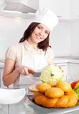 Cook cutting cabbage Royalty Free Stock Photo