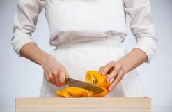 Cook cutting fresh sweet pepper Stock Photo