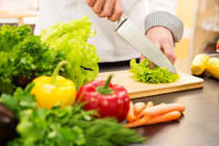 Free Cook Cutting Lettuce, Preparing Vegetable Salad In Kitchen Stock Images - 85205344