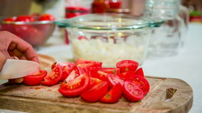 Cook Cutting Tomatoes Into Parts stock video