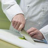 Cook is cutting vegetable Stock Photo