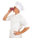 Cook drinking from red cup Stock Image