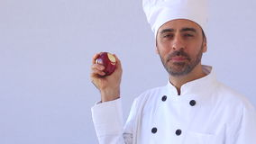 Cook eating an apple stock video footage