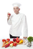 Cook eating red apple Royalty Free Stock Photography