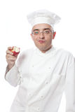 Cook eating red apple Royalty Free Stock Photo