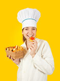 Cook eating tasty pastry Royalty Free Stock Images