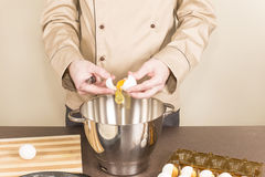 Cook egg retrieves from the shell of Stock Photo