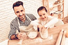 Free Cook Food At Home. Happy Family. Father`s Day. Girl And Man Cooking. Man With Flour On Face. Spend Time Together. Food On Table. Royalty Free Stock Photos - 131404958