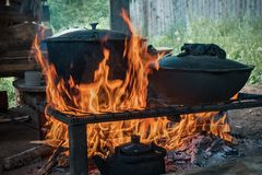 Cook food on burning campfire. Cooking on an open fire. Outdoor cooking. Outdoor food. Cook food on burning campfire. Cooking on an open fire. Outdoor cooking royalty free stock photos