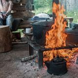 Cook food on burning campfire. Cooking on an open fire. Outdoor cooking. Outdoor food. Cook food on burning campfire. Cooking on an open fire. Outdoor cooking royalty free stock photography