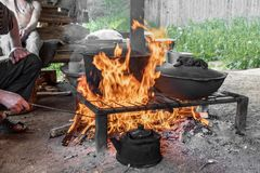 Cook food on burning campfire. Cooking on an open fire. Outdoor cooking. Outdoor food. Cook food on burning campfire. Cooking on an open fire. Outdoor cooking stock images