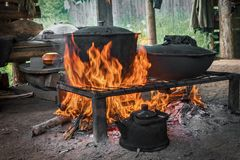 Cook food on burning campfire. Cooking on an open fire. Outdoor. Cooking. Outdoor food stock images
