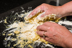 Cook forming dough into pasta noodles royalty free stock images