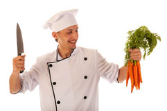 Cook with fresh carrots Stock Photography