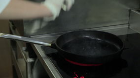 Cook in a frying pan roasting the liver stock video footage