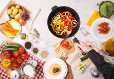 Cook Frying Sliced Vegetables Stock Photo