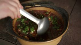 Cook garlic throws in the finished dish. Traditional Ukrainian borsch dish. stock video