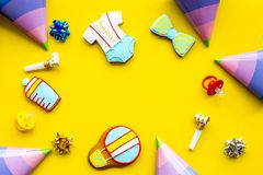 Cook gingerbread cookies with ticker tape for baby shower on yellow colorful background top view mockup Royalty Free Stock Photo