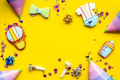 Cook gingerbread cookies with ticker tape for baby shower on yellow colorful background top view mockup Royalty Free Stock Image