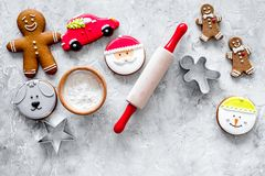 Cook gingerbread for new year 2018. Gingerbread man, rolling pin, flour on stone background top view Stock Images